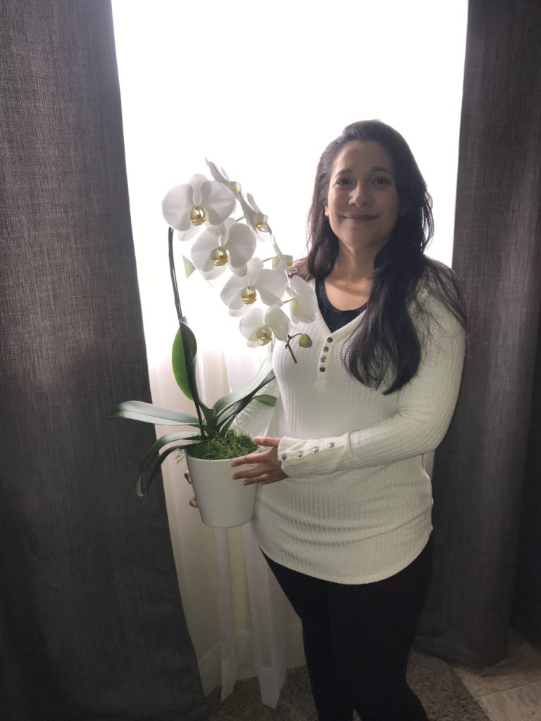 Woman Holding Orchids.
