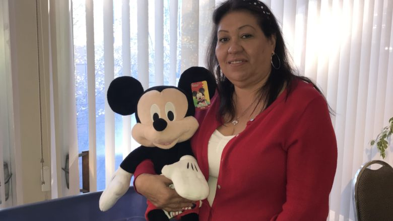 Woman holding Micky Mouse